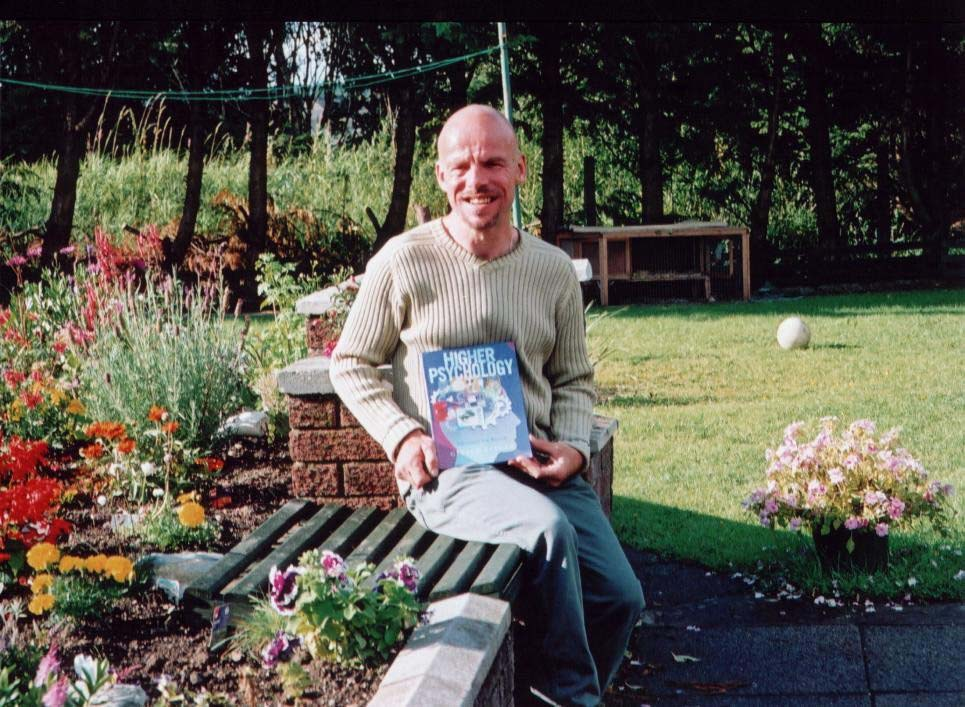 Gerard Keegan holding his first Psychology book